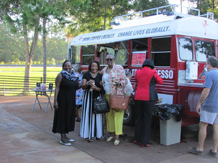 volunteerrs in front of a coffee truck